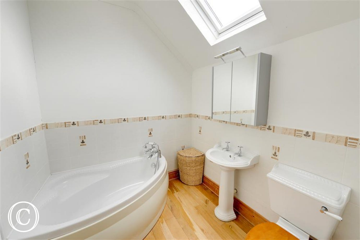 The family bathroom features has a white suite featuring a corner bath