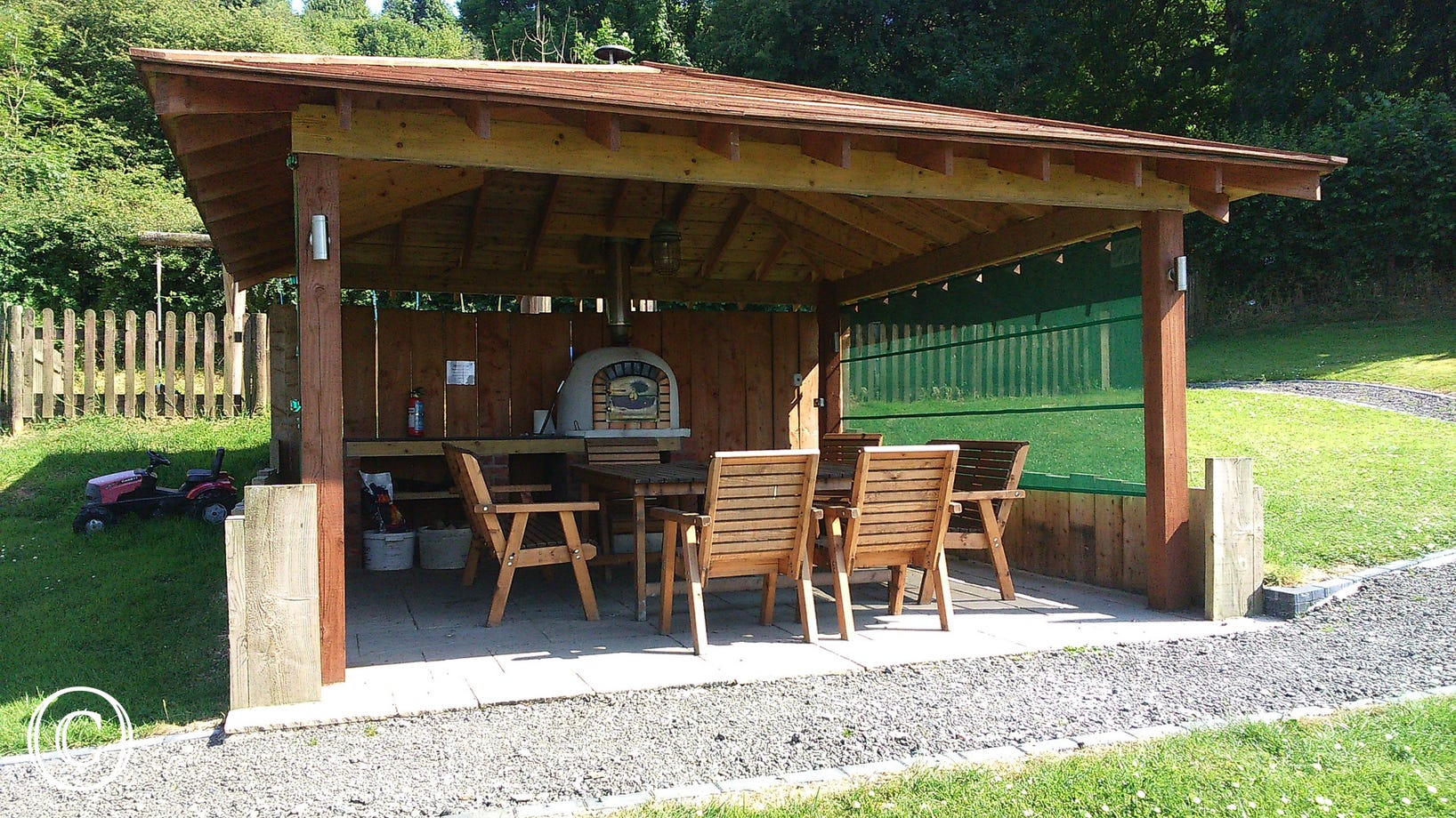 Communal dining area on site with pizza oven