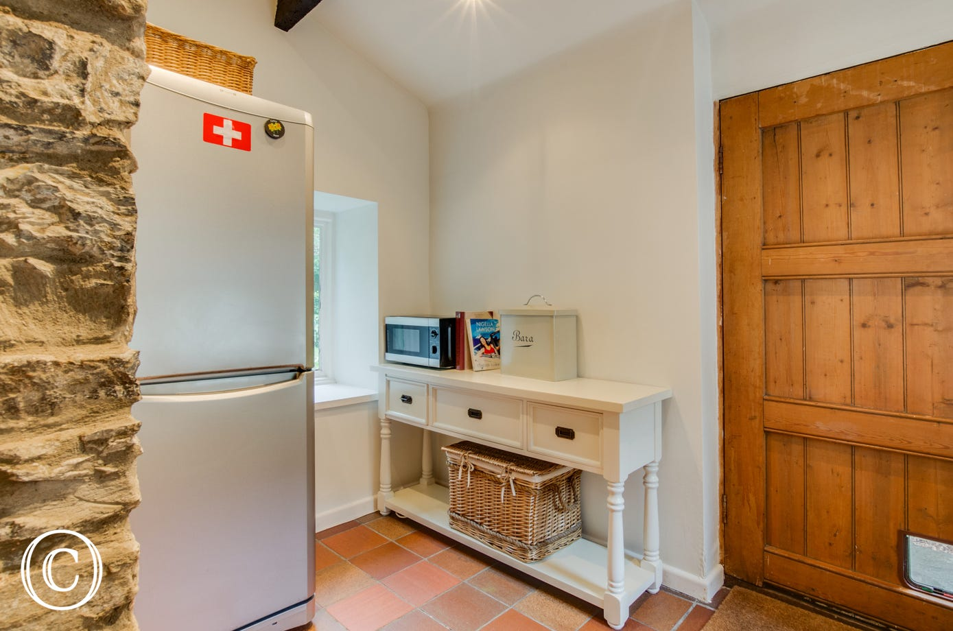 With fridge freezer and washing machine. Door to garden