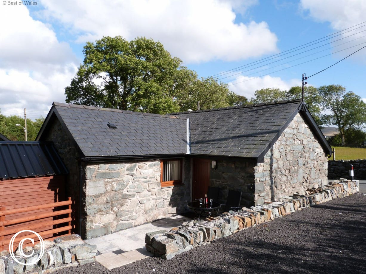 Patio to the rear of this Trawsfynydd accommodation is a real sun trap