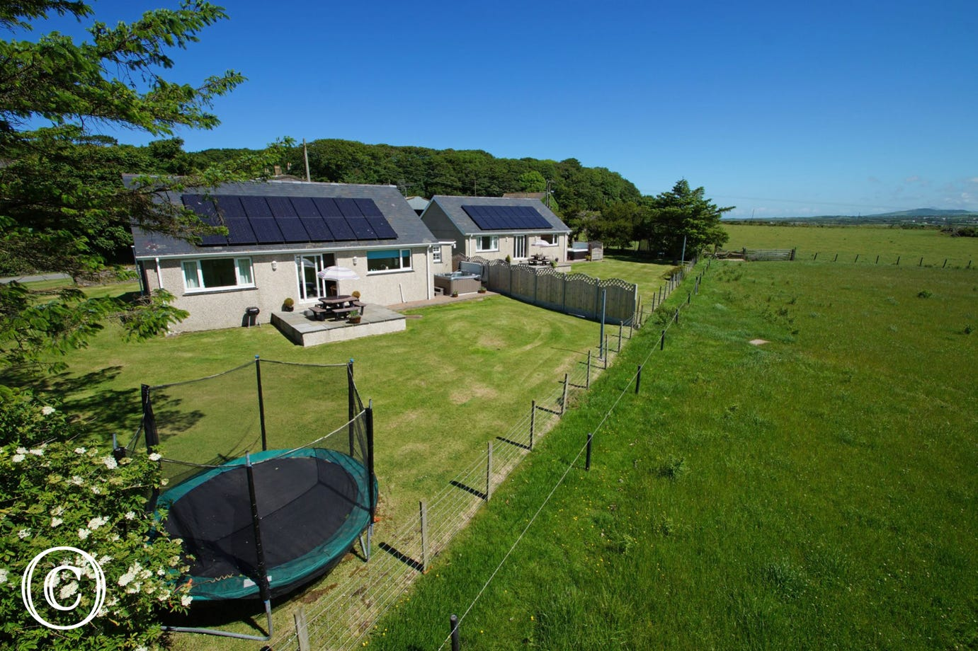 Minffordd (furthest) is one of two 5 star cottages on site - each with its own enclosed garden and hot tub