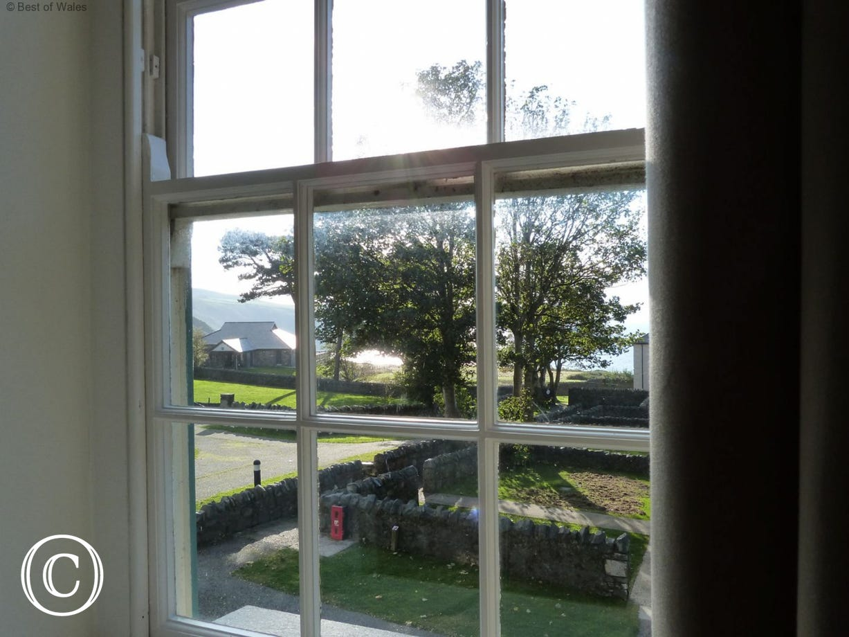 View from the bedroom over the lawn and out to sea