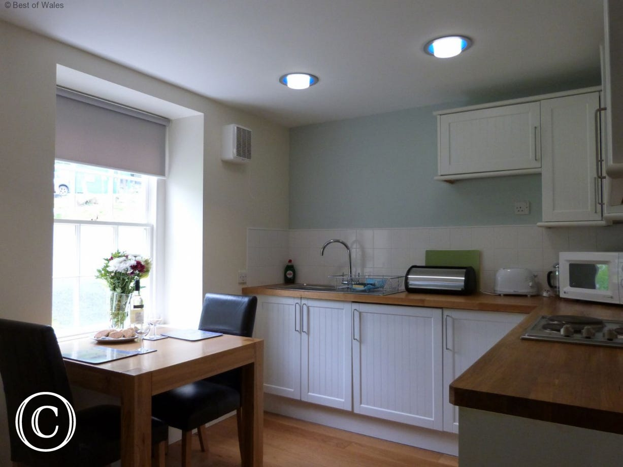 Kitchen and dining room at your cosy cottage in Nant Gwrtheyrn
