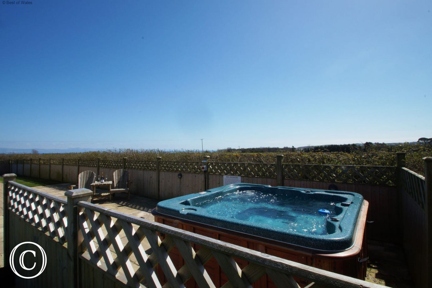 Private hot tub on the patio - perfect for a relaxing holiday