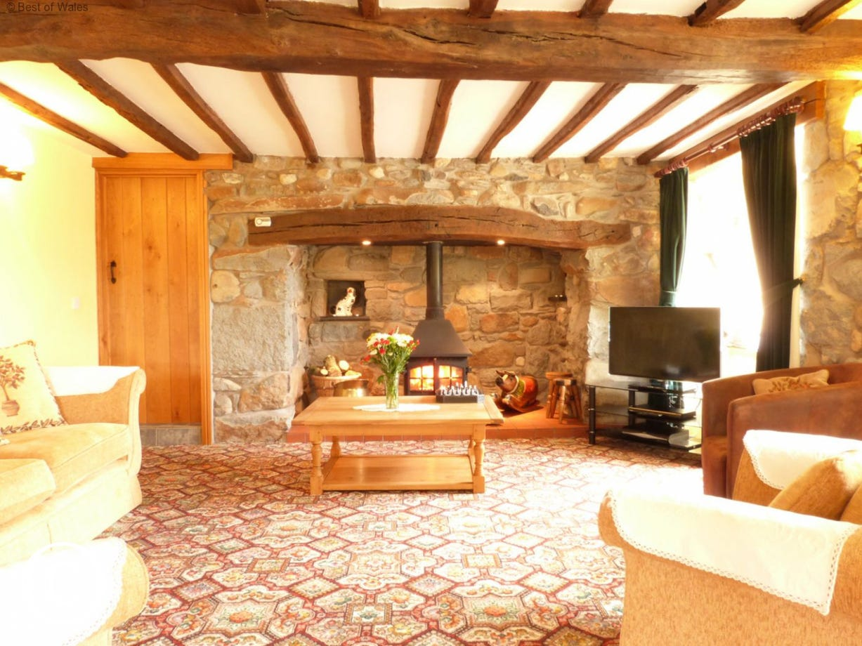 Spacious lounge with original inglenook and welcoming woodburner
