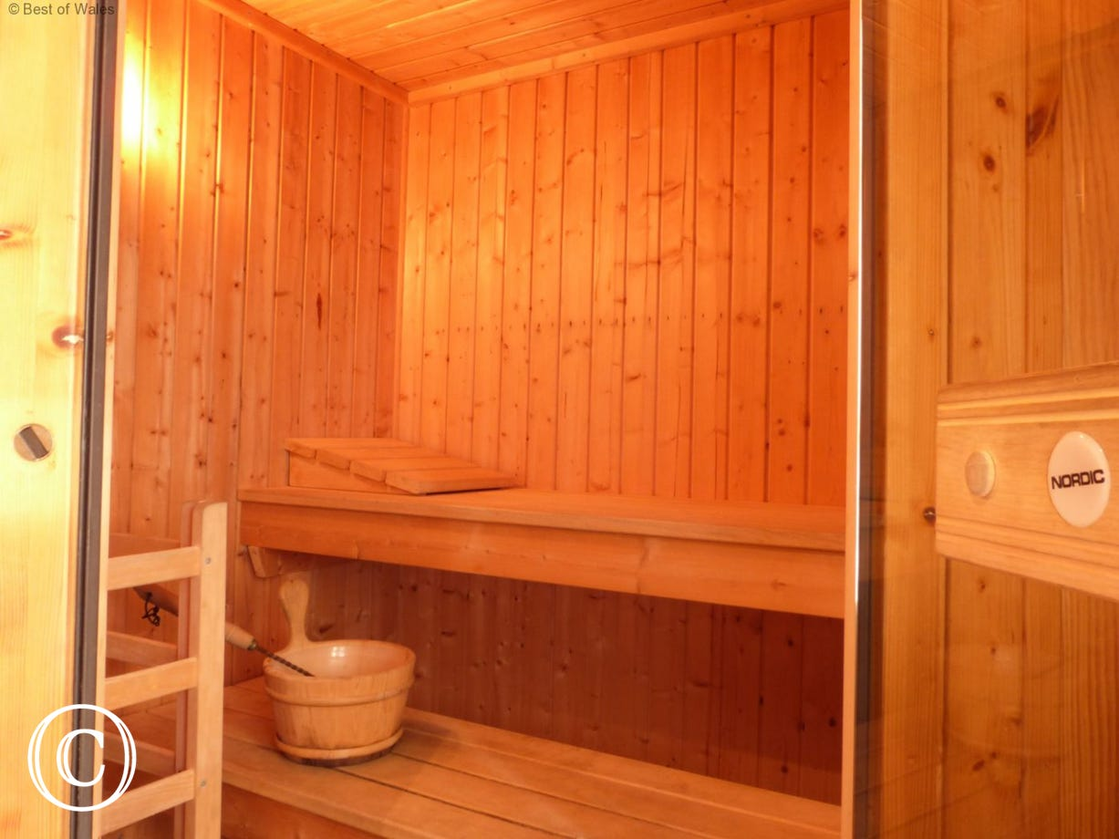 A snug room with a Nordic Sauna to seat 2 - 4 people