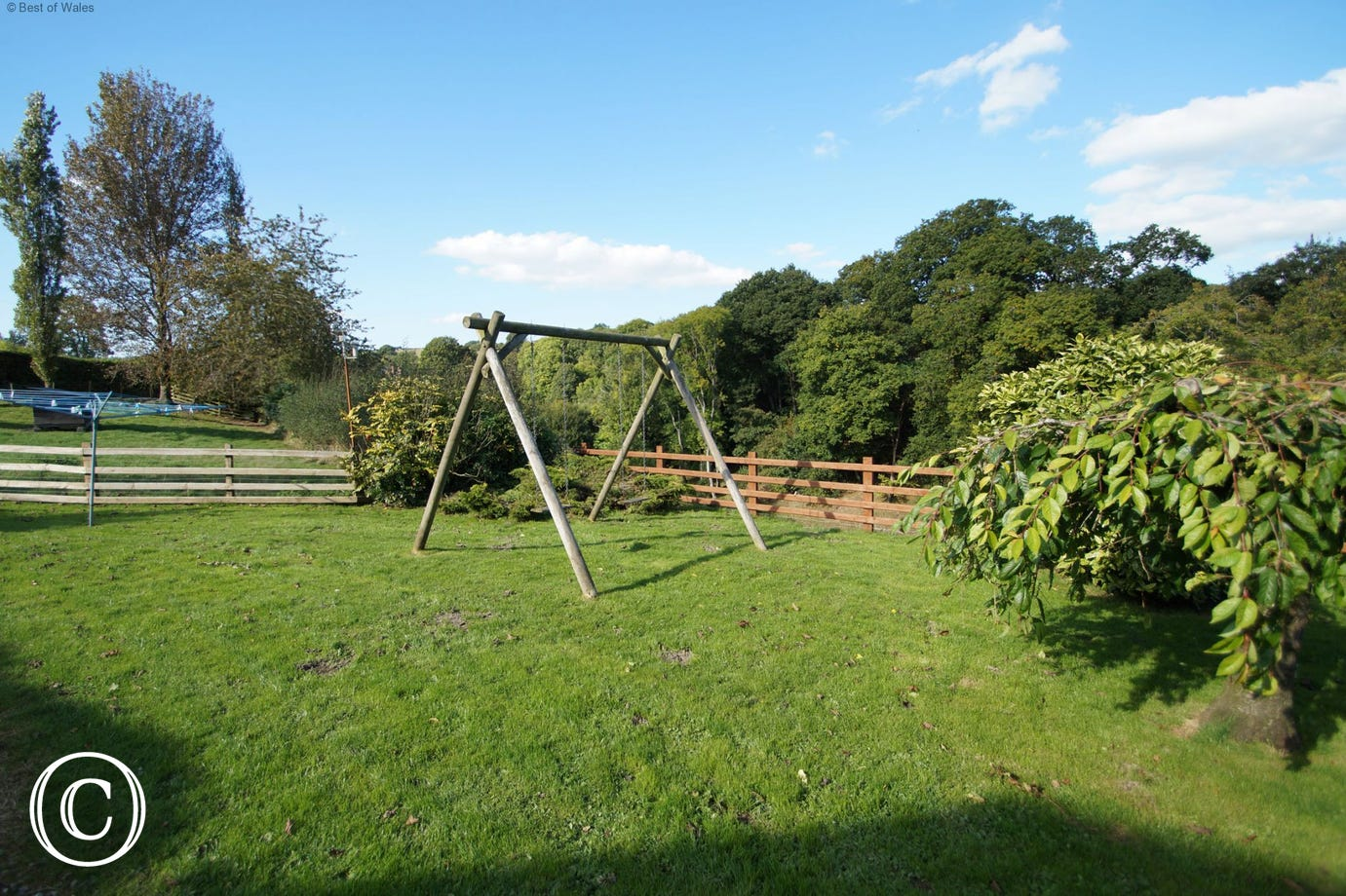 Large, enclosed garden with table & chairs, swings & BBQ facility