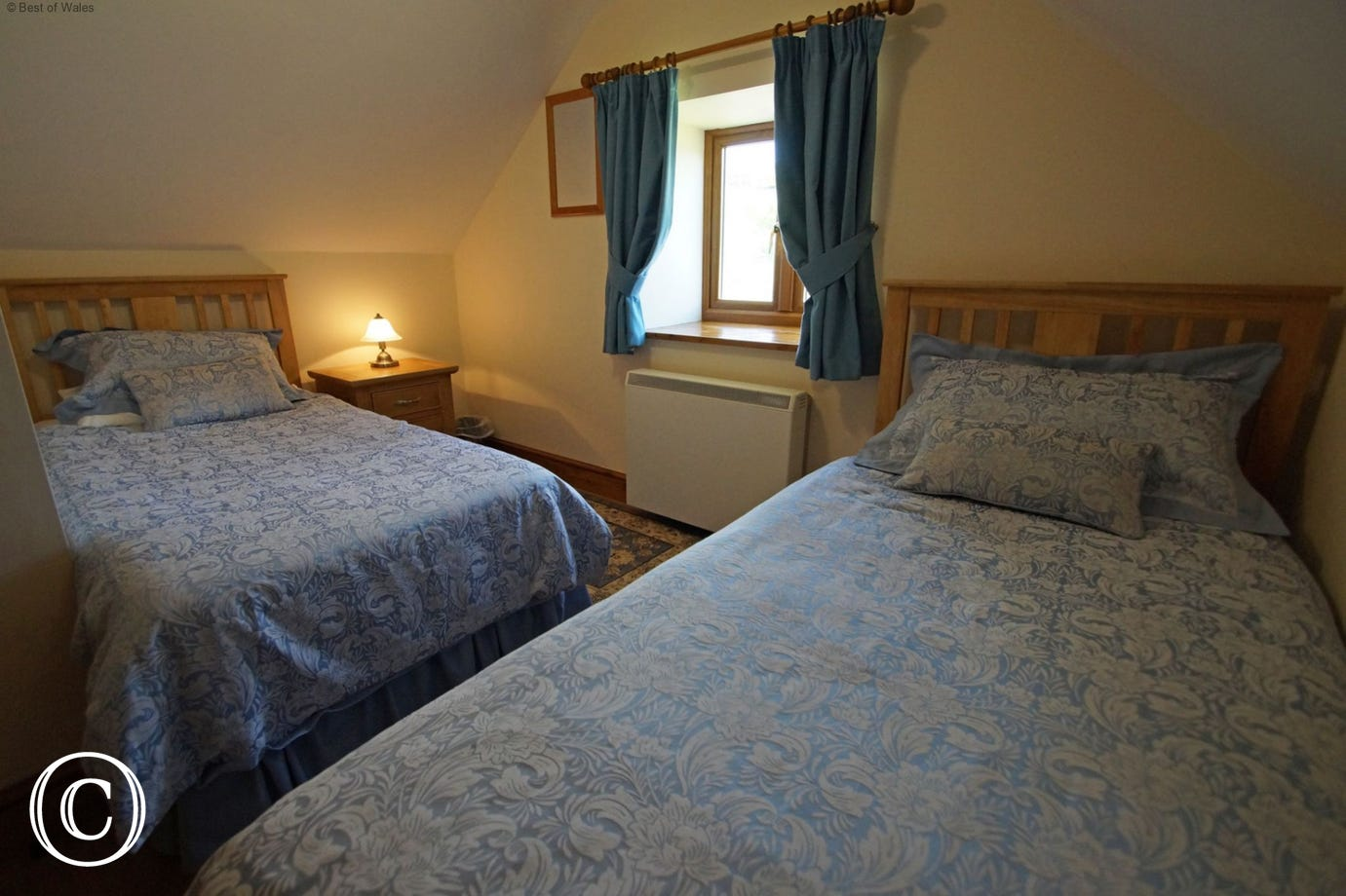 Cosy twin room with chest of drawers and countryside views