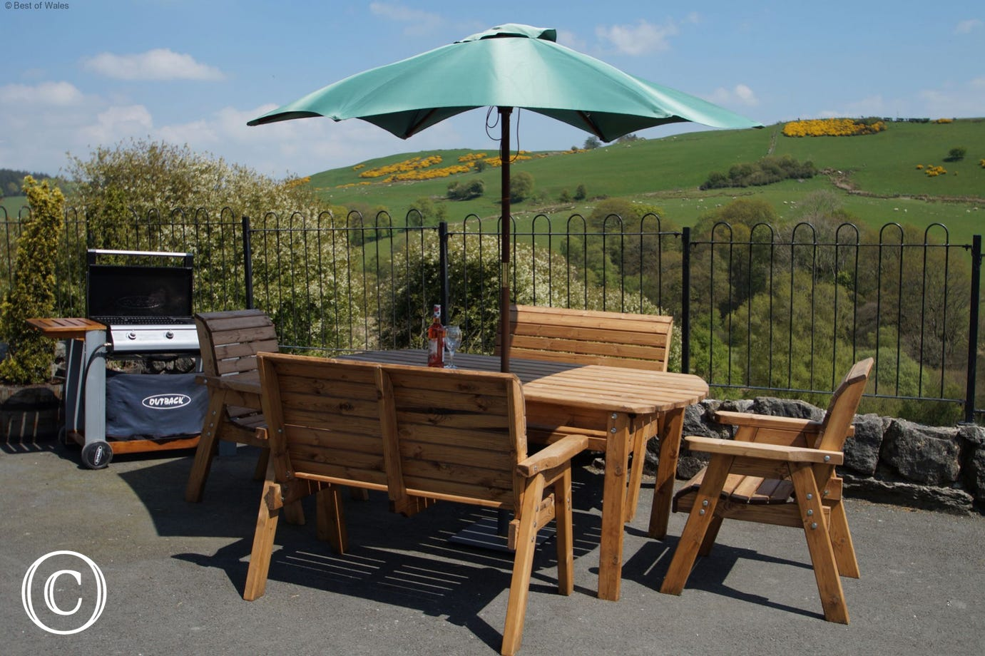 Enclosed patio area includes BBQ, garden table, chairs and great views
