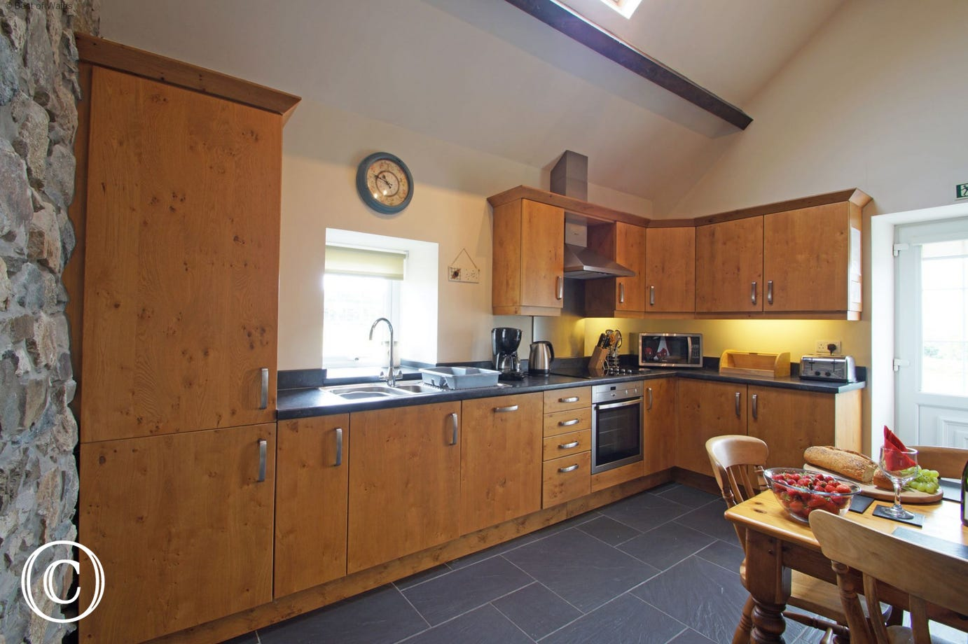 A character oak kitchen with slate floor