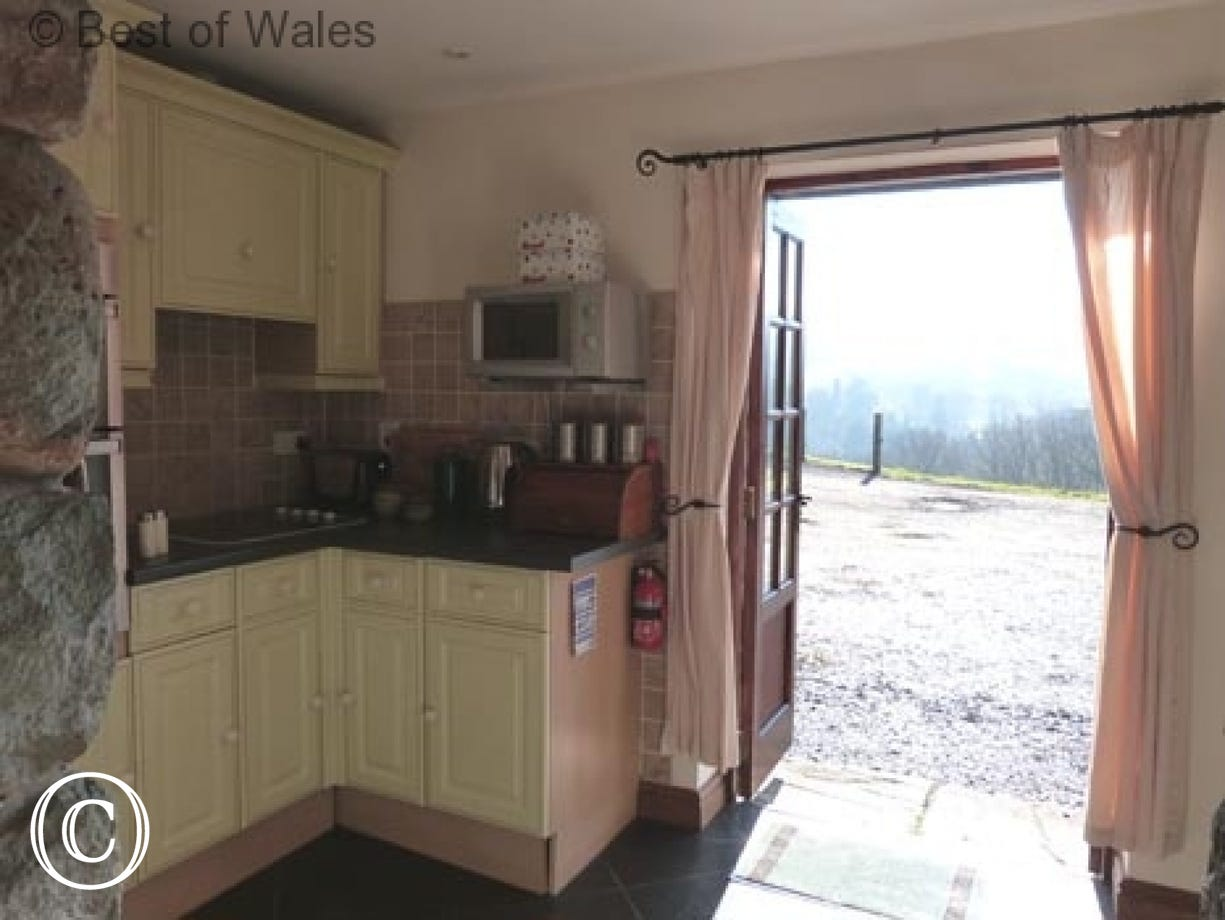 Fully equipped kitchen opens out to magnificent scenery