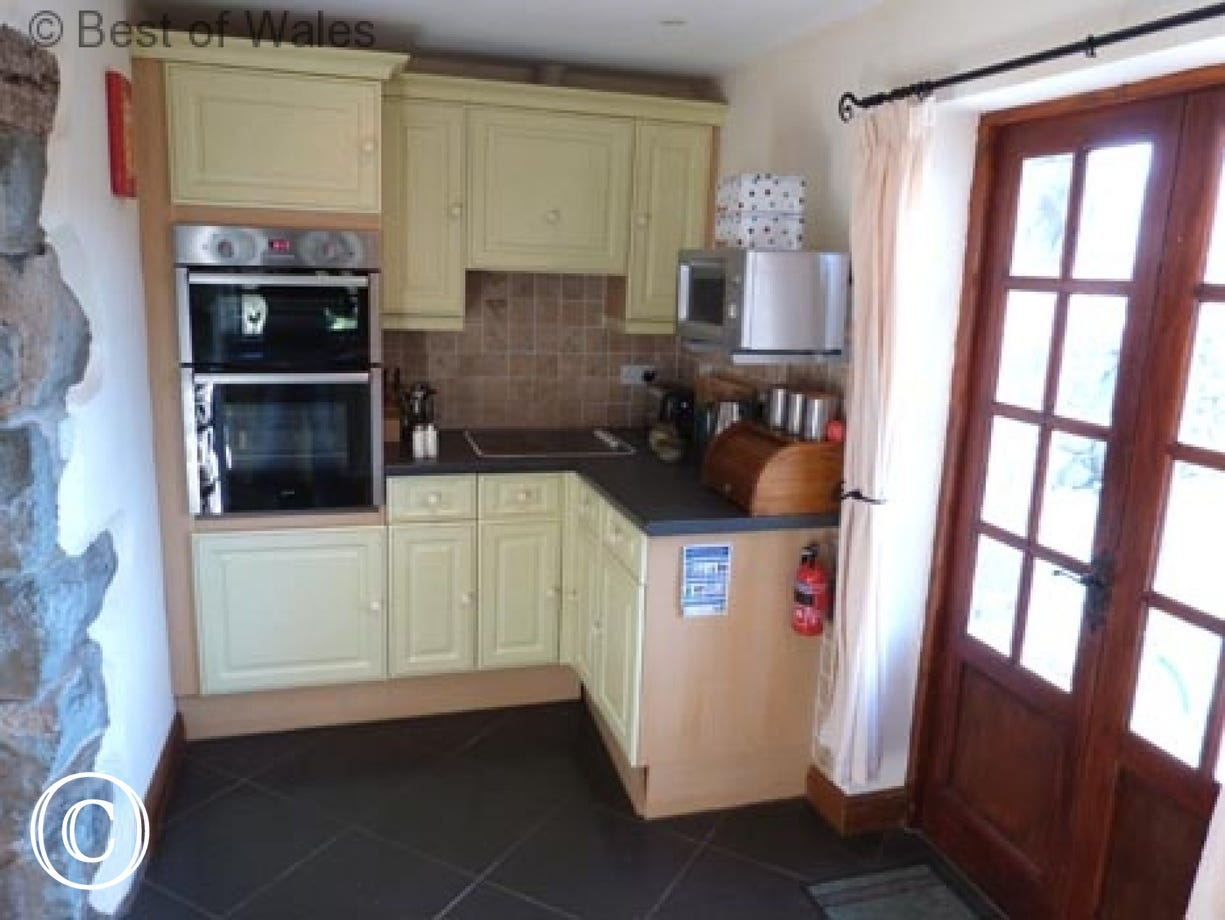 Kitchen includes a double oven, hob and microwave...