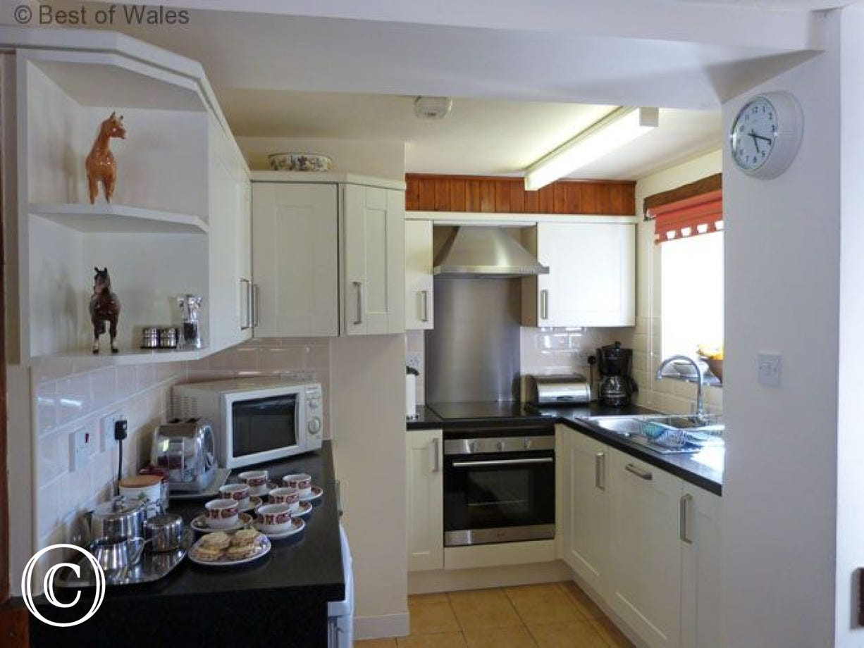 Kitchen includes an electric cooker, fridge, microwave & dishwasher