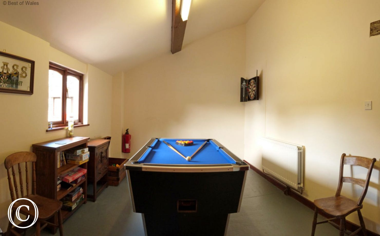 The games room on site includes a pool table and dart board.