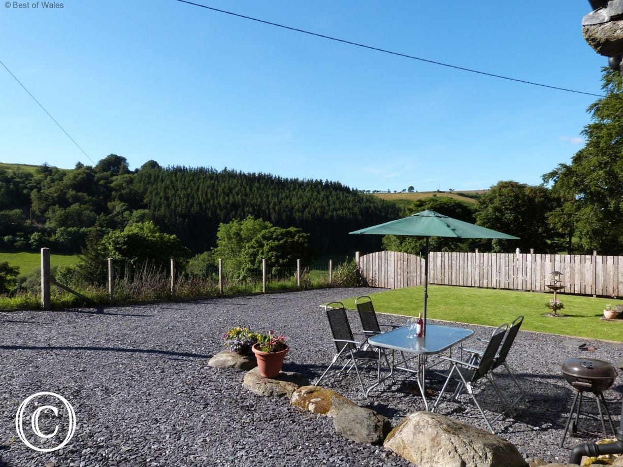Relax in the peaceful, enclosed rear garden with countryside views.