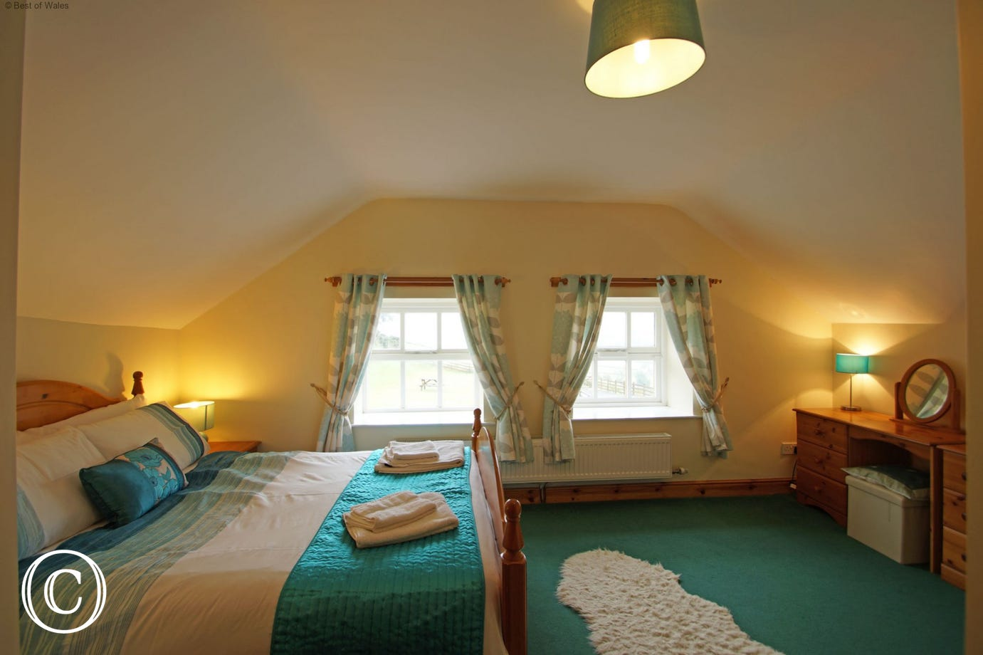The spacious double bedroom offers beautiful views over Snowdonia countryside
