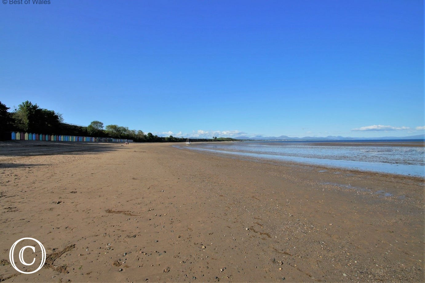 Llanbedrog Beach - a mile long sandy beach with a cafe and huts.