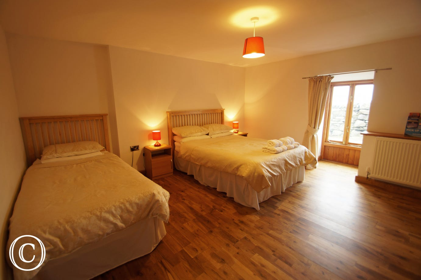 The second bedroom offers a comfy double and a single bed