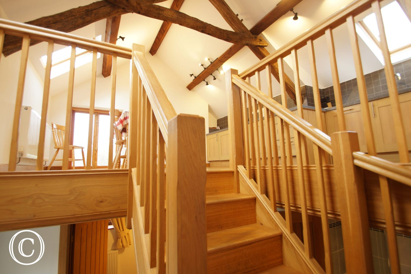 Upstairs living area leading down to the ground floor bedrooms and bathroom