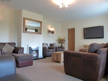 Spacious lounge includes gas fire, 50