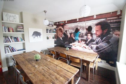 Dining area with huge wall art
